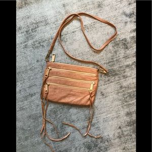 Leather bag with zippers
